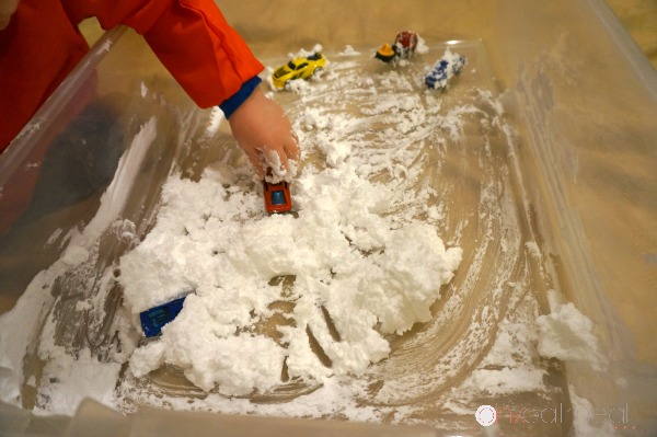 DIY Snow that is perfect for indoor sensory play.  I love how the DIY snow even feels cold when made.  Super fun sensory play experience!