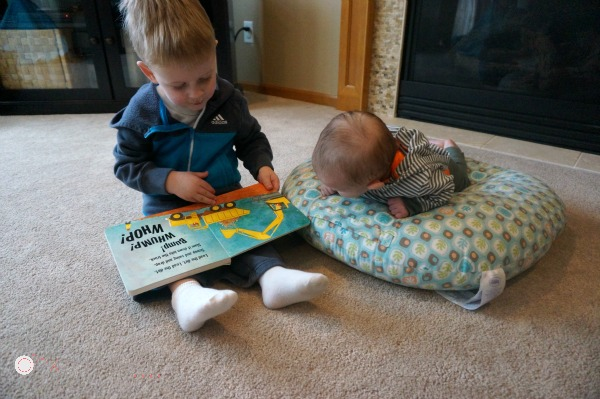 Incorporating Your Toddler In Tummy Time.  This is a great tip for tummy time.  I have trouble coming up with activities for a toddler when my baby is doing tummy time! - Pink Oatmeal