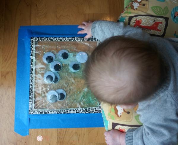 Tummy time sensory bag play! Such a fun baby play idea!
