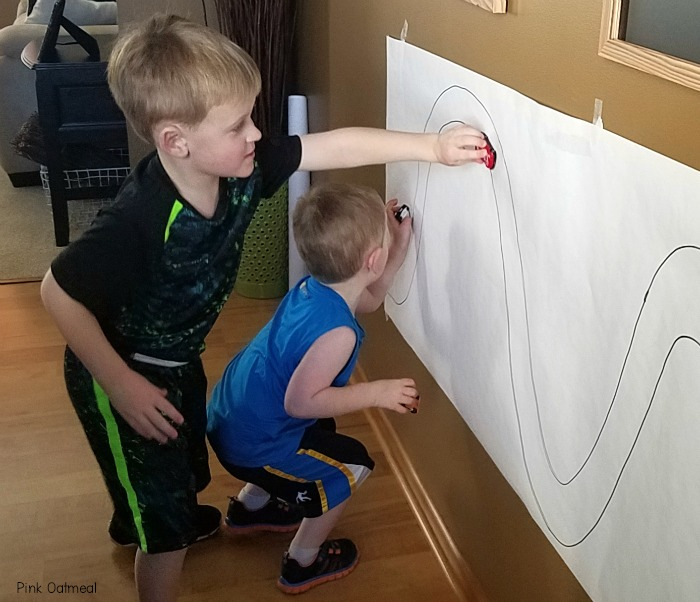 Combining Gross Motor and Fine Motor Skills by working on a Vertical Surface